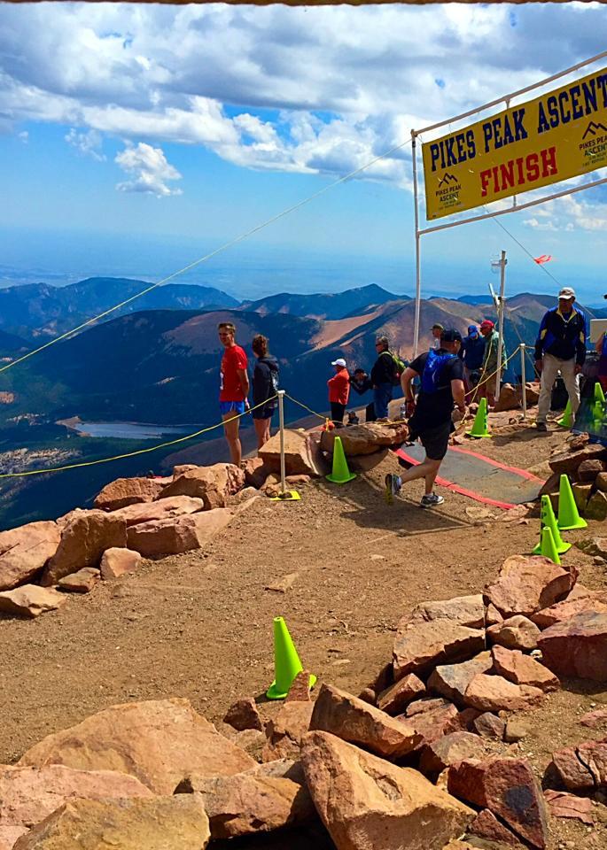 Attorney Josh Keltner completing the Pikes Peak Half Marathon.
